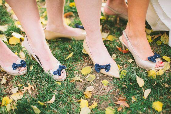 bridesmaids wearing matching shoe clips! photo by Steven Michael - http://ruffledblog.com/nautical-striped-kansas-wedding/