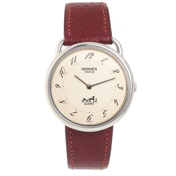 Hermes Stainless Steel Arceau Large Quartz Wristwatch | From a unique collection of vintage wrist watches at https://www.1stdibs.com/jewelry/watches/wrist-watches/