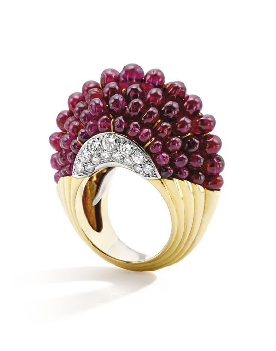 18 Karat Gold, Platinum, Ruby Bead and Diamond 'Boule' Ring, Cartier, Paris Of bombé form, with seven rows composed of ruby beads, accented at the sides with round diamonds weighing approximately 1.15 carats, gross weight approximately 18 dwts, size 6½, signed Cartier Paris, with French assay and workshop marks.