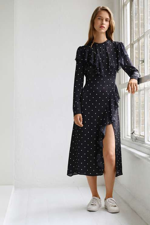 Go pretty in polka dot with this dress by Boutique. Featuring frill detailing to shoulders and arms, this dress also comes with tie neck detailing and a midi-cut. #Topshop