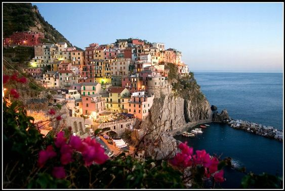 Cinque Terre, Italy.....{{{sigh}}} those hill would kill me, but I would still give it a try.