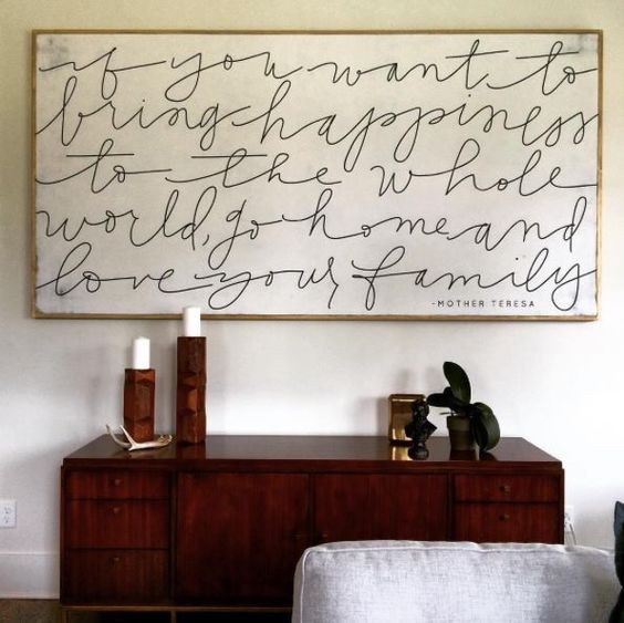 """This artwork by The House of Belonging in Rebekah Lyons' home gives us all the holiday feels, """"If you want to bring happiness to the whole world, go home and love your family."""""""