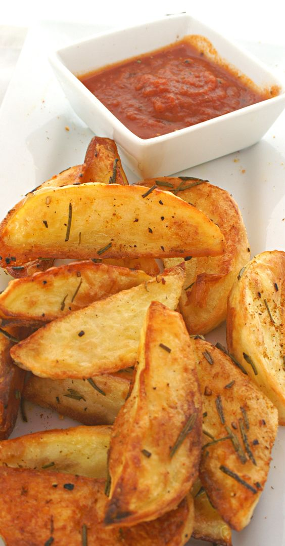 Rosemary Roasted Garlic Potato Wedges - Everybody loves potatoes. These are crunchy little packages of salty crispy delight. Click here for more healthy, delicious gluten free recipes from The Cave Woman. http://www.goingcavewoman.com/rosemary-roasted-garlic-potato-wedges #potatowedges #frenchfries #potatorecipes