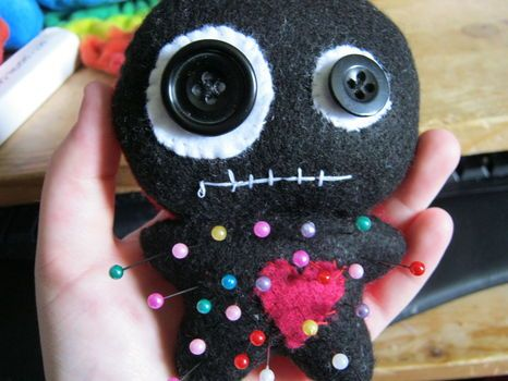 Voodoo doll pincushion.... so darn cute!  http://www.cutoutandkeep.net/projects/voodoo-doll_2