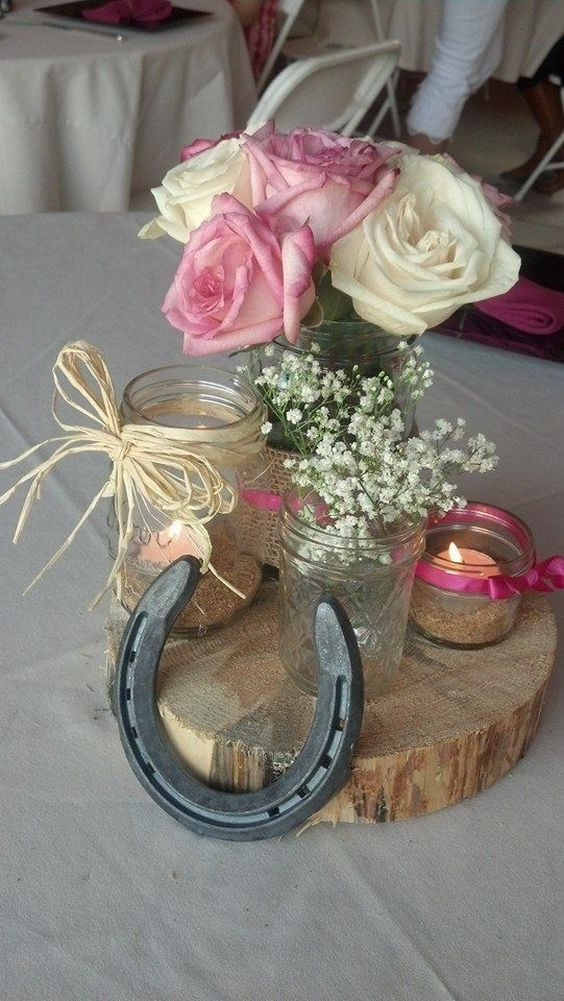 Rustic wedding shower center pieces using all different sizes mason jars / http://www.deerpearlflowers.com/rustic-farm-wedding-horseshoe-ideas/