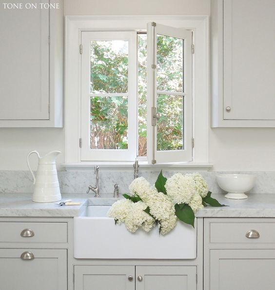 """Tone on Tone. Our kitchen with gray cabinets, farm sink and 2"""" thick Carrara marble countertops"""