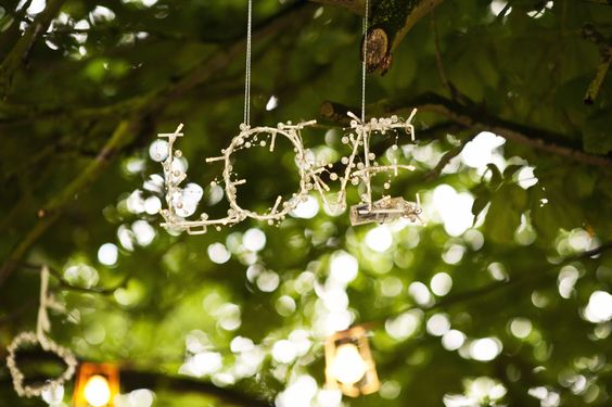 Wooded walkway from car park to tipis, filled with hearts, lights and bunting #wedding #decorations #love