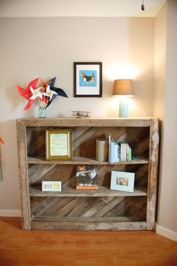 Bookcase made from old barn wood (but could also use wood pallet!) - love this rustic touch to the nursery!