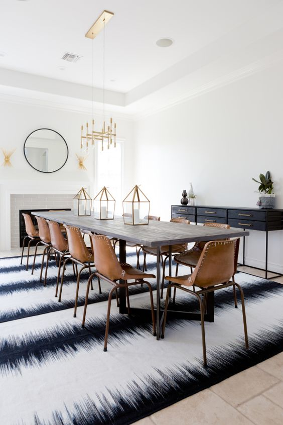 Extra long dining room table, leather school house chairs, and brass chandelier: http://www.stylemepretty.com/living/2016/09/16/see-how-a-party-stylist-translates-her-cool-girl-style-into-her-home-x2/ Photography: Amy Bartlam - http://www.amybartlam.com/: