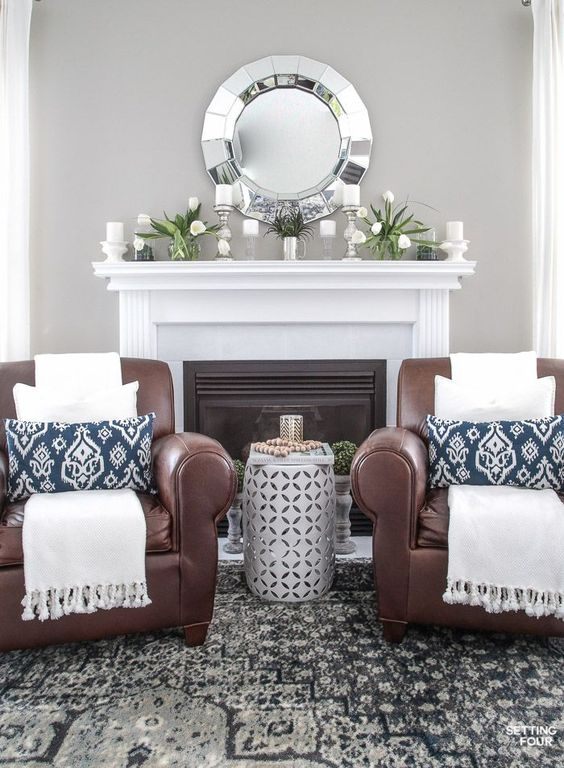 Spring Home Tour! See this beautiful home and family room decorated for Spring. Leather club chairs, indigo blue accents, garden stool end table and Spring mantel decor. Get the look - see the shopping sources and design ideas!