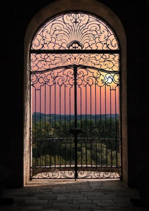 beautiful Mediterranean sunset thru lovely iron gates