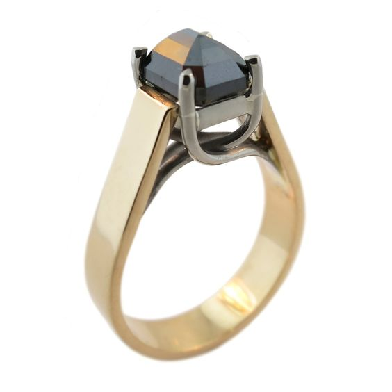 This ring features a 2.08ct Emerald Cut Black Diamond, set upside down, in a 18ct white gold four claw lucinda style setting.Setting the Black Diamond upside down shows all the facets off and creates an interesting twist on a normal solitaire diamond ring.Designed and handmade at Cameron Jewellery by Peter Cameron.