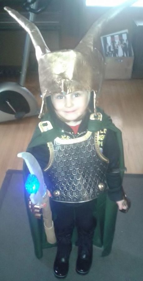 This is the finished Loki Halloween outfit for my 4 year old daughter. The helmet is made from cardboard and paper mache. The scepter I made from foam and a light. The armor I bought at the dollar store, I painted the gold trim on and tied green fabric to it. I spray-painted everything with a nice gold coat. I'm pretty happy with the way everything turned out and she loved it.