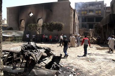 Egyptians gathered in the ruins of the Evangelical Church of Malawi after it was ransacked, looted, and burned on Thursday by an angry mob, in Malawi, south of Minya, Egypt, Saturday. In the province of Minya, protesters attacked two Christian churches, security officials said.