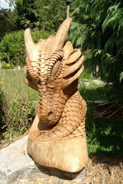 Chainsaw carved dragons paul frenette carving