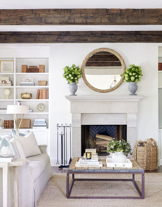 Neutral living room with wood beams and green accents