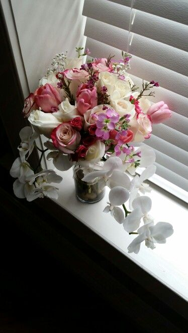 Bridal bouquet that I made for my sister-in-law for her wedding. Roses, spray roses, stock, tulips, wax flower & orchids. Beautiful!