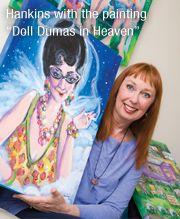 "Little Rock, Ark., artist Jane Hankins with painting ""Doll Dumas in Heaven."""