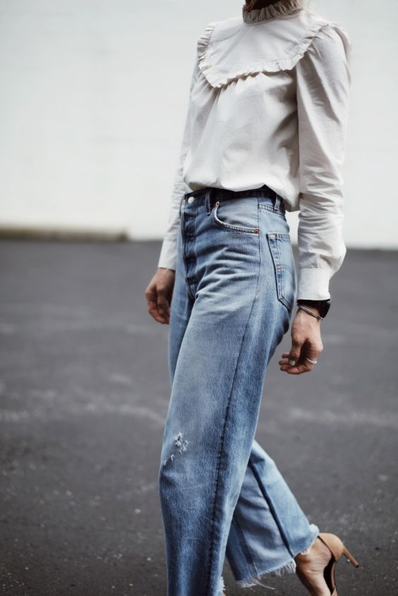 high neck blouse shirt tucked into blue jeans, 80s mum mom style vintage