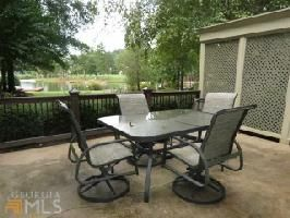 140 N Hidden Lake Dr, Eatonton, GA 31024  What a beautiful view from the patio of this beautiful lake home. Come see for yourself how gorgeous this property is both inside and out.