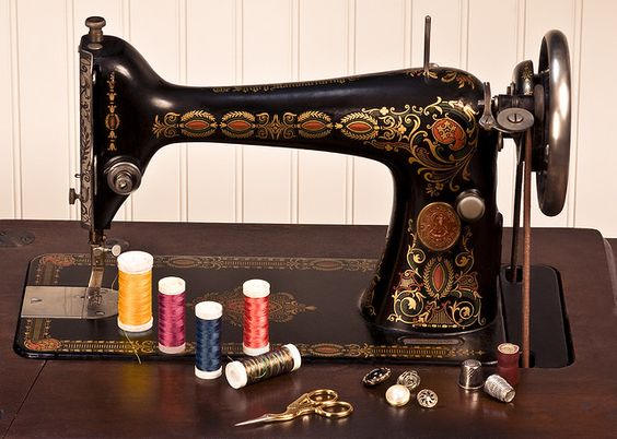 old sewing machine and threads