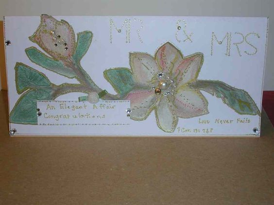 "Wedding Card An Elegant Affair "" Mr & Mrs"" with a quote from Corinthian. All Handmade  Magnolia Flowers Silver Gold and Hand-Painted Flowers. Pearl and Crystal accents"