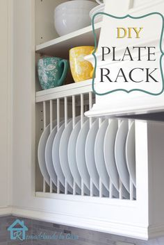 DIY plate rack...  Perhaps paint the inside of one of the cabinets and add some wallpaper in the back?  Take off the front and build this?