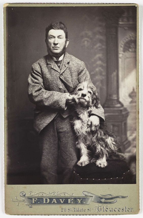 Man posing for portrait with his adorable dog - vintage.