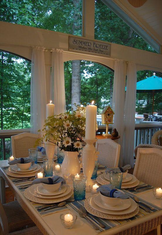 navy/white placemats, white dishes, navy/white napkins, white pillars, white vase, candles, flowers