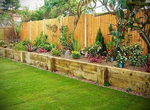 I like raised beds and these ones are really tidy. It looks like they're made with old scaffold boards, Nell