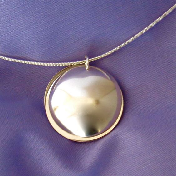 Sterling silver locket with extra room inside for your message.  Personalized jewelry by Dream Acre Designs.
