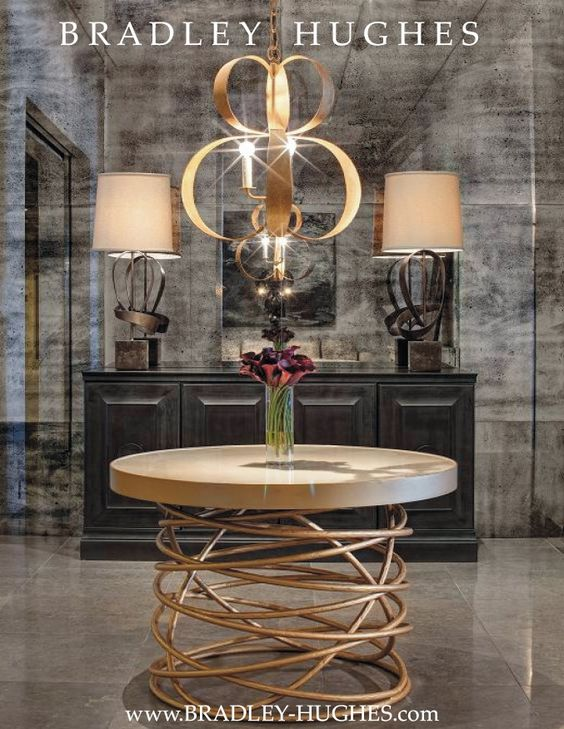 Former Chicago BRADLEY HUGHES Showroom.  Merchandise Mart Suite 1855.    BRADLEY HUGHES products shown in this photo:  Bianca Center Table, Bernard Console, 2 Dean Lamps, Lucille Chandelier, Antique Mirror Wall Panels. Photo by Eric Hausman:
