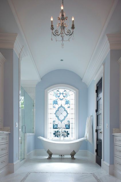 Incredible ~ gorgeous pale powder blue and crisp white ~ elegant bathroom! The stained glass window is amazing!