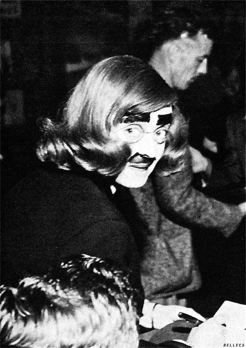 Bette Davis in Groucho Marx disguise at the Hollywood Canteen during WWII: