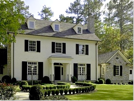 White painted brick with black shutters pinned for the for Colonial brick