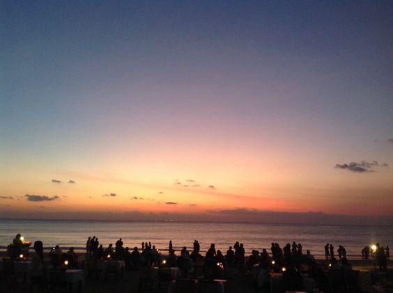 Enjoy Sunset at Jimbaran bay with seafood on the table