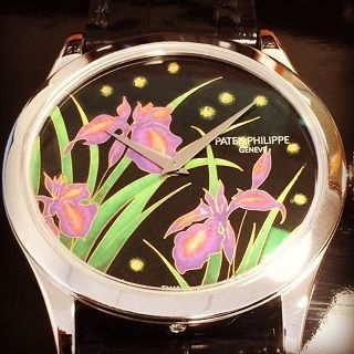 Patek Philippe Ref. 5077 Iris and Fireflies platinum wristwatch with cloisonne enamel dial offered in Antiquorum's July 9 auction in Hong Kong. Est: $80,000 -$120,000.