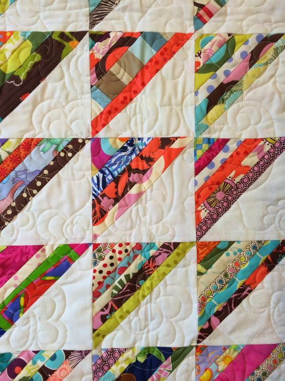String pieced half square triangles - another great scrap quilt!: