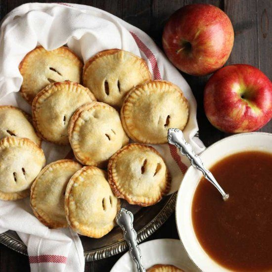 Buttery and flaky apple hand pies with a sweet and decadent apple caramel sauce for dipping or drizzling.