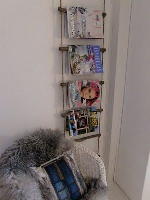 hanging magazine rack made from driftwood/sticks and rope