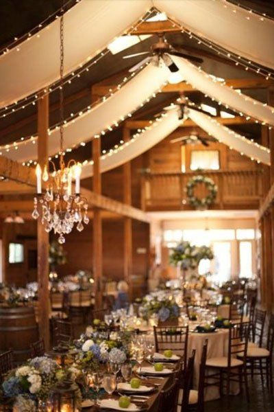 Material and light swags for rustic room at Boat House space, Rehearsal Dinner.