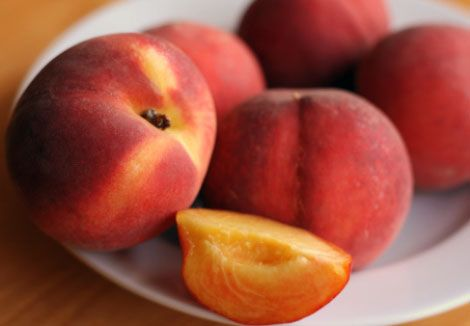 Eating a perfectly ripe peach.