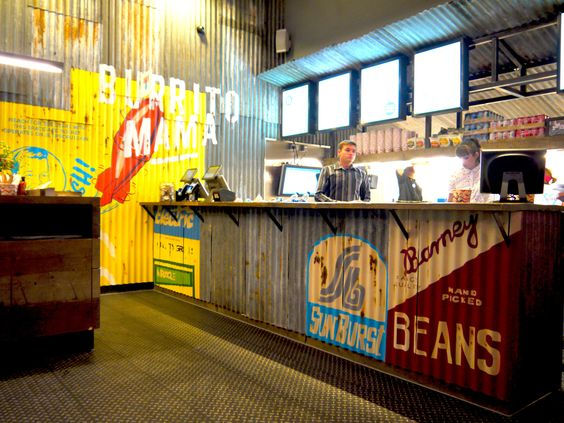 """Now this is a cool interior-- it's a restaurant called """"burrito Mama""""  They utilized tin roofs to produce a very industrial design look to it.   It's quite similar to Chipotle."""