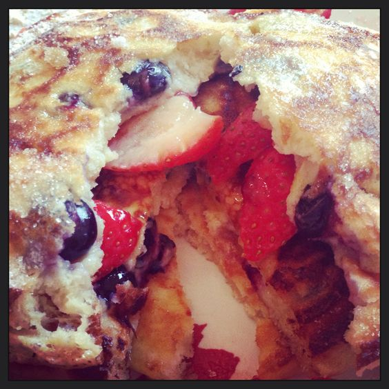 Blueberry pancakes with fresh strawberries - I out fruit in there that's still clean right ;)