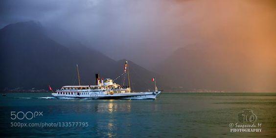 a journey.. http://ift.tt/1PwaAJe Montreuxcloudslakemountainsreflectionshipsunsettravel