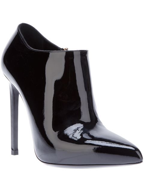 Compre Saint Laurent Ankle boot preta em Biondini Paris from the world's best independent boutiques at farfetch.com. Over 1000 designers from 300 boutiques in one website.