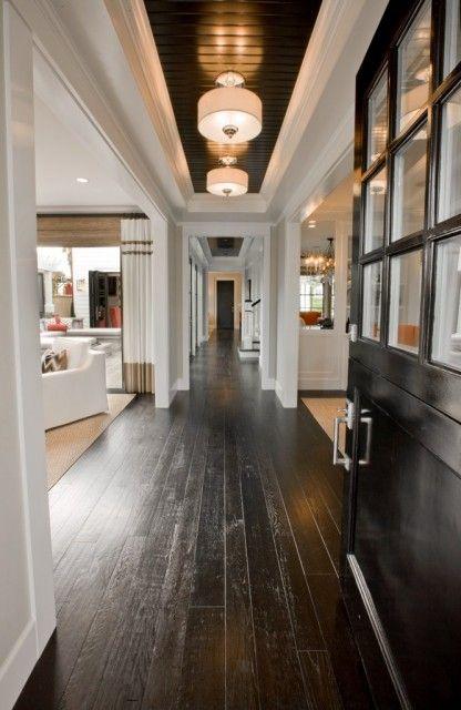Love the long hallway and dark wood.