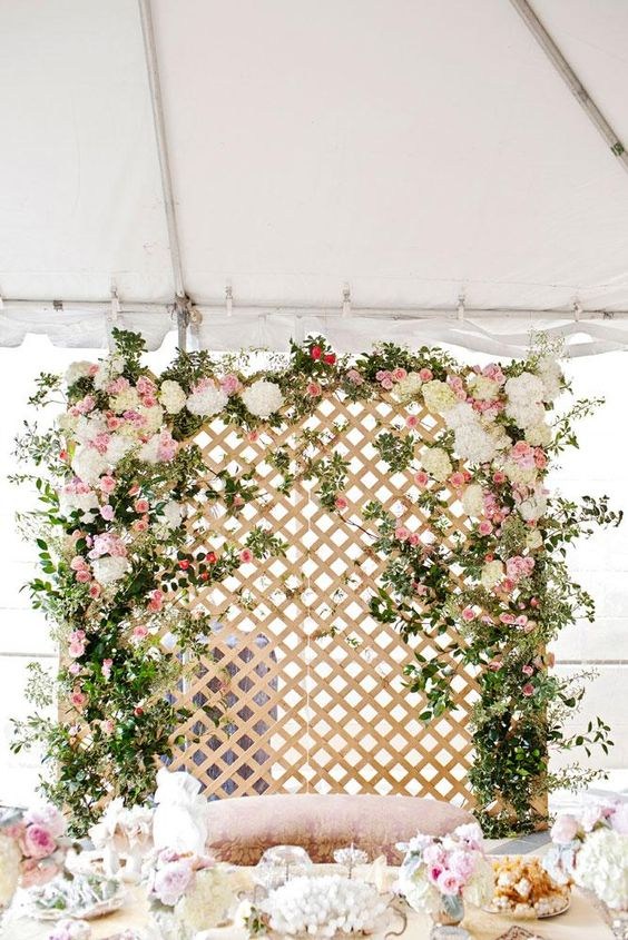 Dreamy floral lattice backdrop by Bows + Arrows for the wedding ceremony. Photo by Perez Photography.: