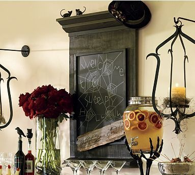 words of welcome in spiderweb on chalkboard