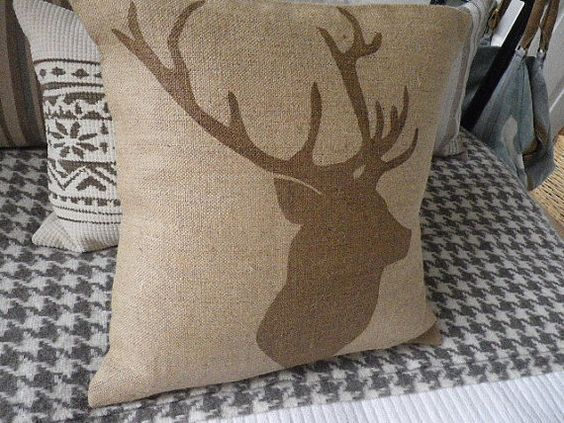 Hand printed in Wiltshire on a natural hessian ground with a muted acorn brown stags head silhouette. An iconic image and an equally classic design